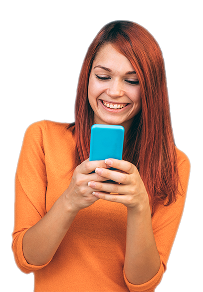 giggling girl in orange shirt staring at her cell phone