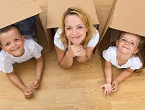 Mom and two kids playing in boxes